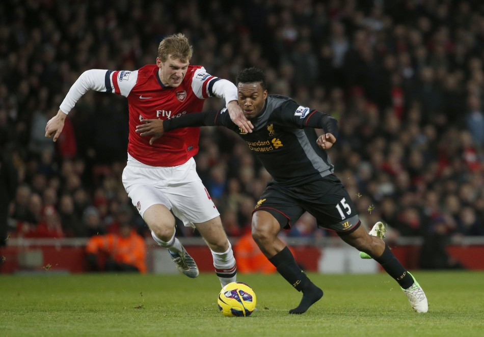 Daniel Sturridge battles Arsenal's Per Mertesacker