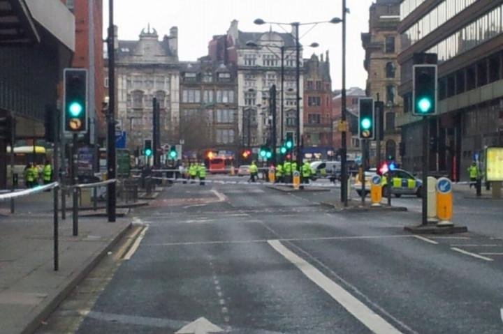 Police on Portland Street, Manchester city centre. (Twitter/@baldkojak)