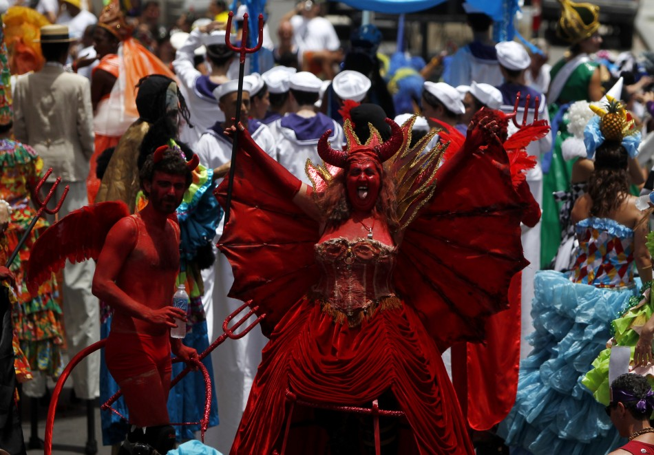 """Revellers dressed as a devil parties in one of the """"blocos"""" in preparation of the Rio de Janeiro Carnival (Reuters)"""
