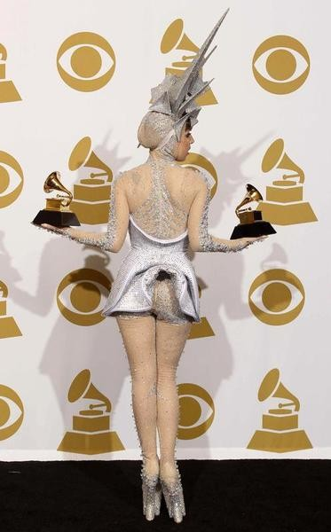 Lady Gaga holds her two Grammy awards for best dance album and best dance recording at the 52nd annual Grammy Awards in Los Angeles January 31, 2010.