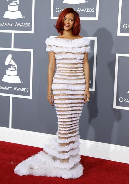 Singer Rihanna poses in an outfit designed by Jean Paul Gaultier upon arrival at the 53rd annual Grammy Awards in Los Angeles, California February 13, 2011.