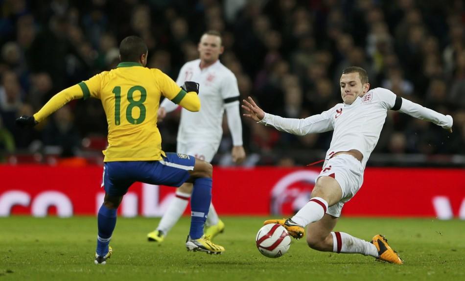 Wilshere battles for the ball with Brazil's Lucas
