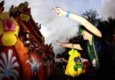 A reveler screams for beads as members of the Krewe of Endymion parade down Orleans Avenue during the weekend before Mardi Gras in New Orleans, Louisiana February 9, 2013. Mardi Gras day will be celebrated on February 12, 2013.