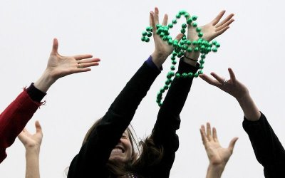 Revelers catch beads as members of the Krewe of Endymion parade down Orleans Avenue during the weekend before Mardi Gras in New Orleans, Louisiana February 9, 2013. Mardi Gras day will be celebrated on February 12, 2013.