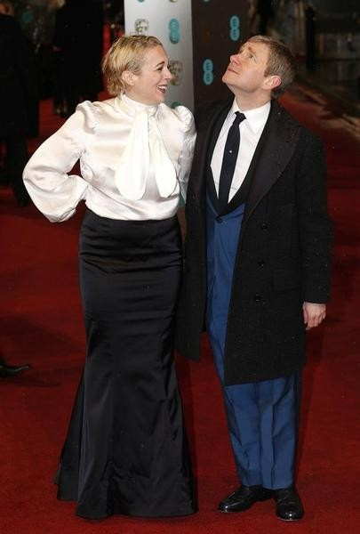 Martin Freeman poses with his wife Amanda Abbington as they arrive for the British Academy of Film and Arts BAFTA awards ceremony at the Royal Opera House in London February 10, 2013.