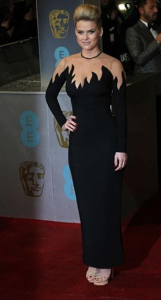 Actress Alice Eve poses as she arrives for the British Academy of Film and Arts BAFTA awards ceremony at the Royal Opera House in London February 10, 2013.