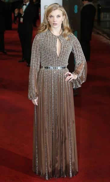 Natalie Dormer poses as she arrives for the British Academy of Film and Arts BAFTA awards ceremony at the Royal Opera House in London February 10, 2013.