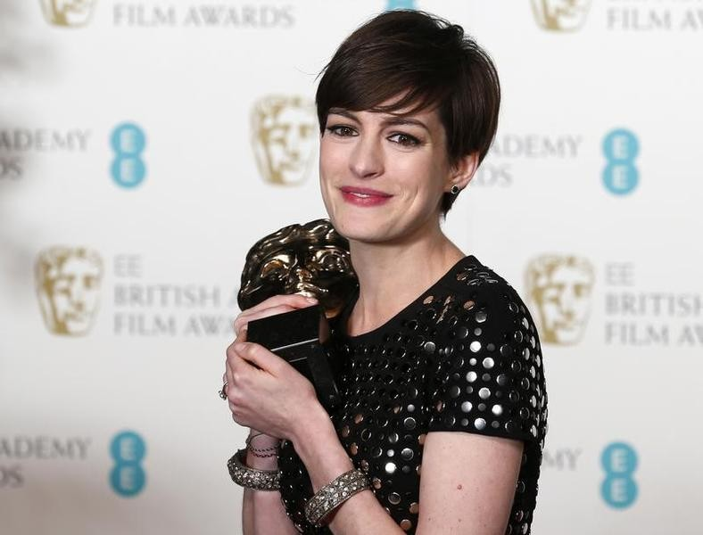 """Anne Hathaway celebrates after winning the Best Supporting Actress award for """"Les Miserables"""" at the British Academy of Film and Arts (BAFTA) awards ceremony at the Royal Opera House in London February 10, 2013."""