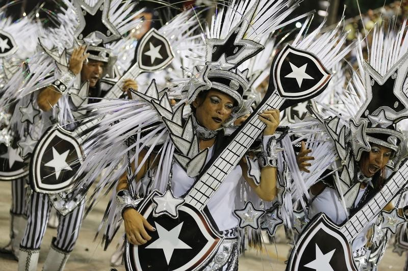 Revellers of Mocidade Independente samba school participate on the first night of the annual Carnival parade in Rio de Janeiros Sambadrome, February 11, 2013.