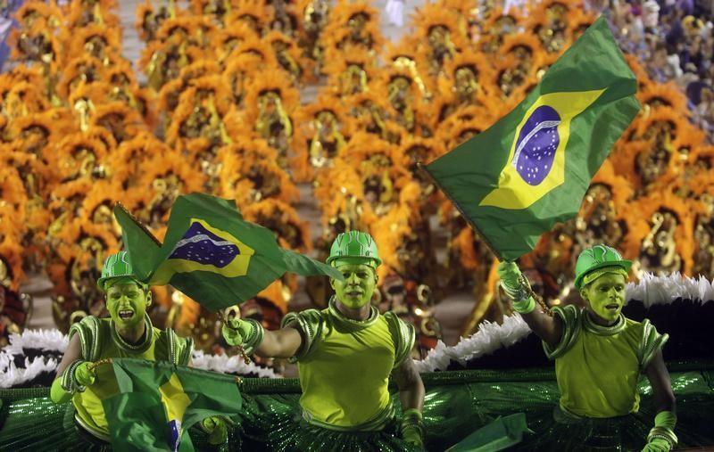 Revellers of the uniao da ilha  Uniao da Ilha samba school participate on the first night of the annual Carnival parade in Rio de Janeiros Sambadrome, February 11, 2013.
