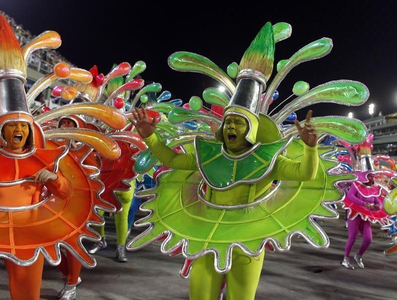 Revellers of the uniao da ilha Uniao da Ilha samba school participate on the first night of the annual Carnival parade in Rio de Janeiros Sambadrome, February 11, 2013