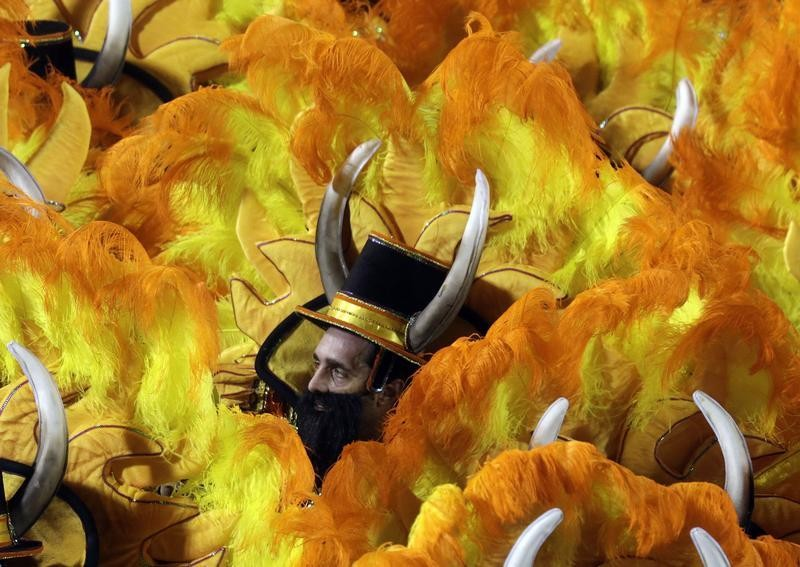 Revellers of the Unidos da Tijuca samba school participate in the annual carnival parade at Rio de Janeiros Sambadrome, February 10, 2013.
