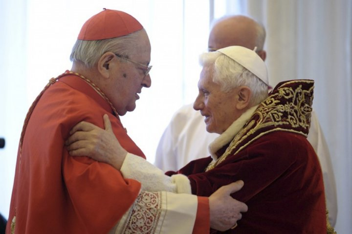 Pope Benedict XVI (R) embraces Cardinal Angelo Sodano during a consistory at the Vatican February 11, 2013, in this picture provided by Osservatore Romano.