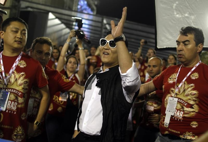 South Korean singer Psy greets revellers during the second night of the A Group annual Carnival parade in Rio de Janeiros Sambadrome February 9, 2013.