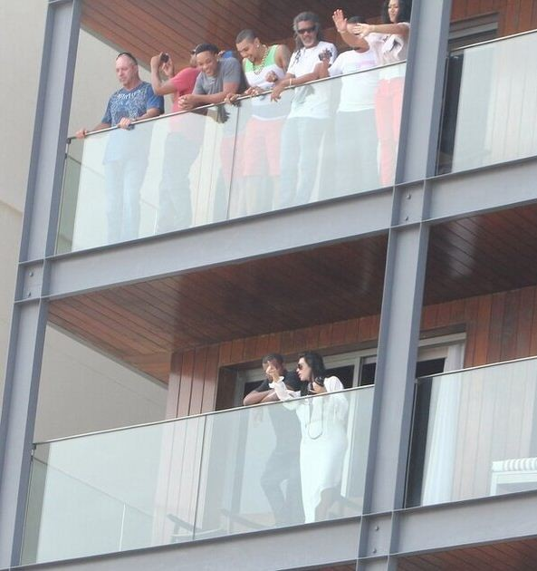 Kanye West, Kim Kardashian and  Will Smith on the Balcony of the hotel in Ipanema