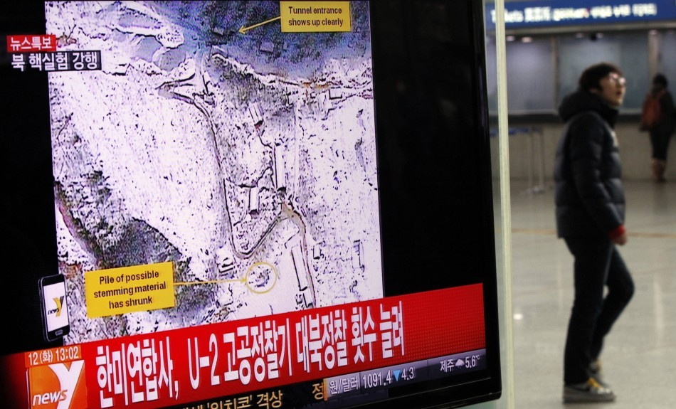 A passenger walks past a television report on North Korea's nuclear test at a railway station in Seoul - Reuters