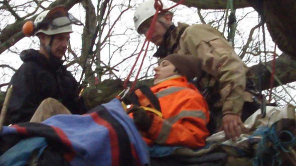 Natalie hoisted from tree-top protest spot