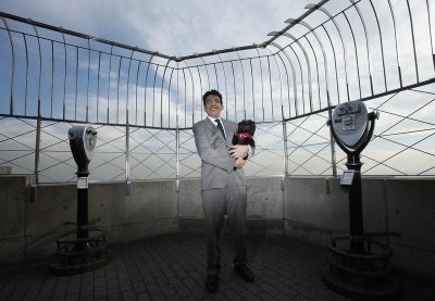 Handler Ernesto Lara holds Banana Joe, an Affenpinscher, on top of the Empire State Building following his Best in Show win last night at the 137th Westminster Kennel Club Dog Show, in New York February 13, 2013.