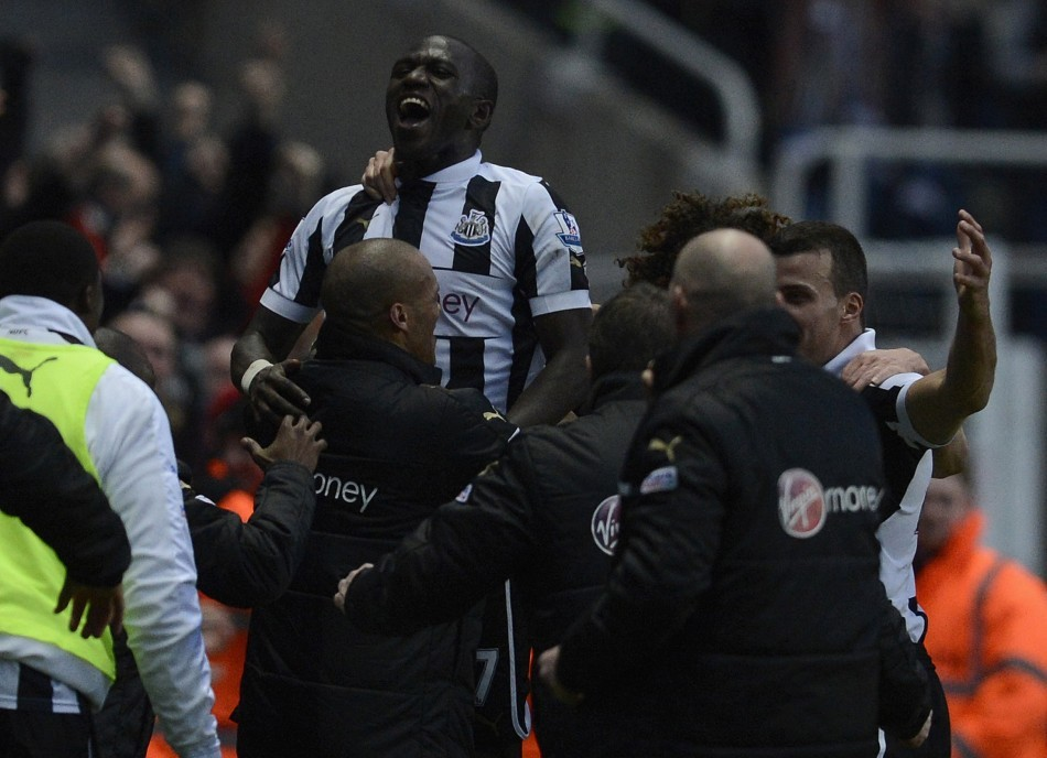 Newcastle United's Moussa Sissoko celebrates with teammates after scoring a goal against Chelsea during their English Premier League soccer match in Newcastle