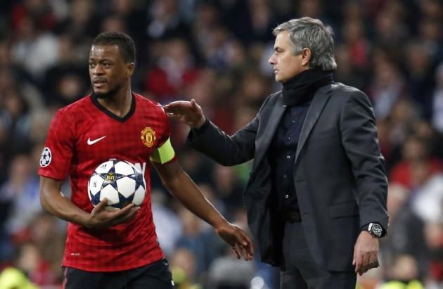 Patrice Evra (L) and Jose Mourinho