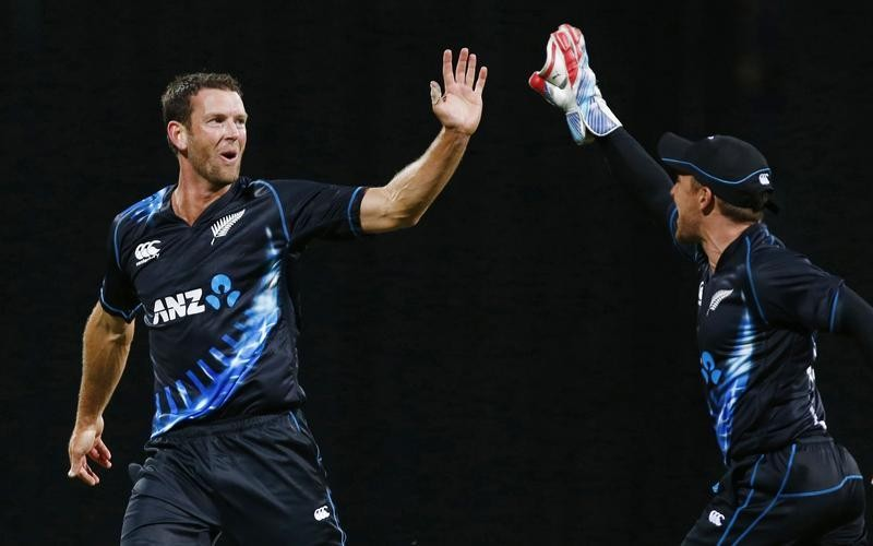 Brendon McCullum (R) and  Ian Butler