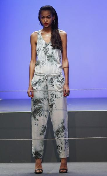 A model presents a creation from the Rihanna for River Island AutumnWinter 2013 collection during London Fashion Week, February 16, 2013.