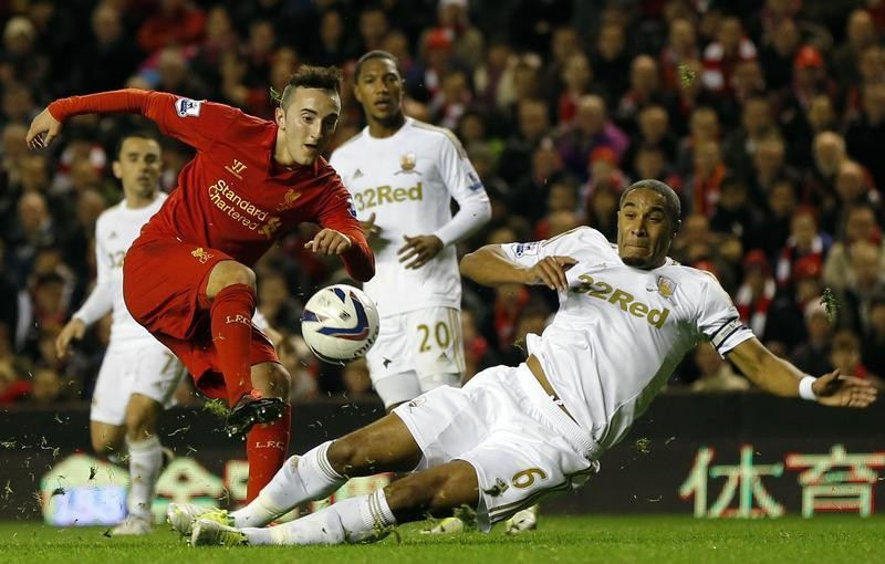 Samed Yesil and Ashley Williams (R)