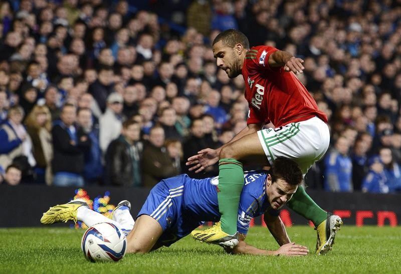 Ashley Williams challenges Cesar Azpilicueta
