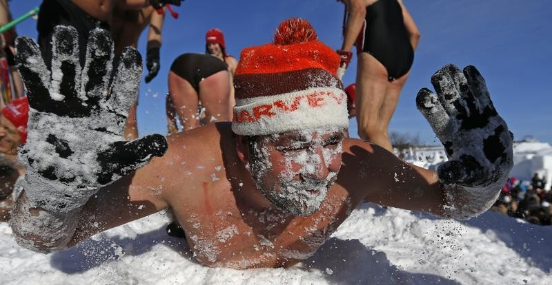A man plays in the snow during the snow bath at the Quebec Winter Carnival on the Plains of Abraham in Quebec City, February 16, 2013.