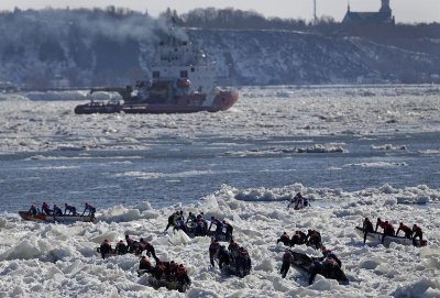 Canoeists compete during the Quebec Winter Carnival ice canoe race on the St. Lawrence river in Quebec City, February 10, 2013.