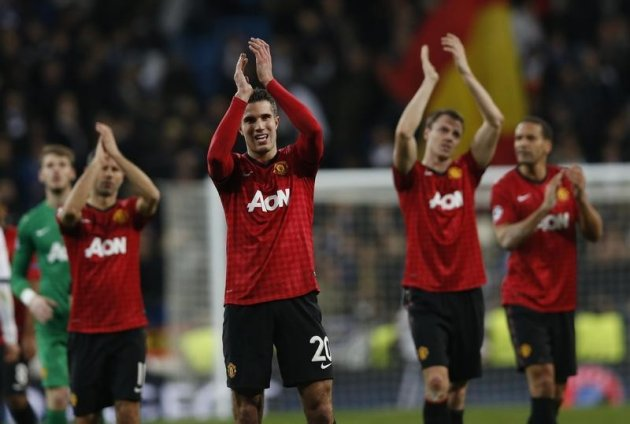 van Persie applauds the United supporters at Santiago Bernabeu