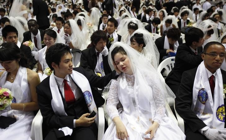 Mass Moonie Wedding in South Korea as over 3,000 couples tie the knot
