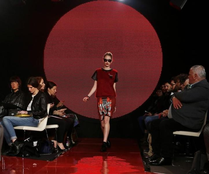A model presents a creation from the Holly Fulton AutumnWinter 2013 collection during London Fashion Week, February 17, 2013.