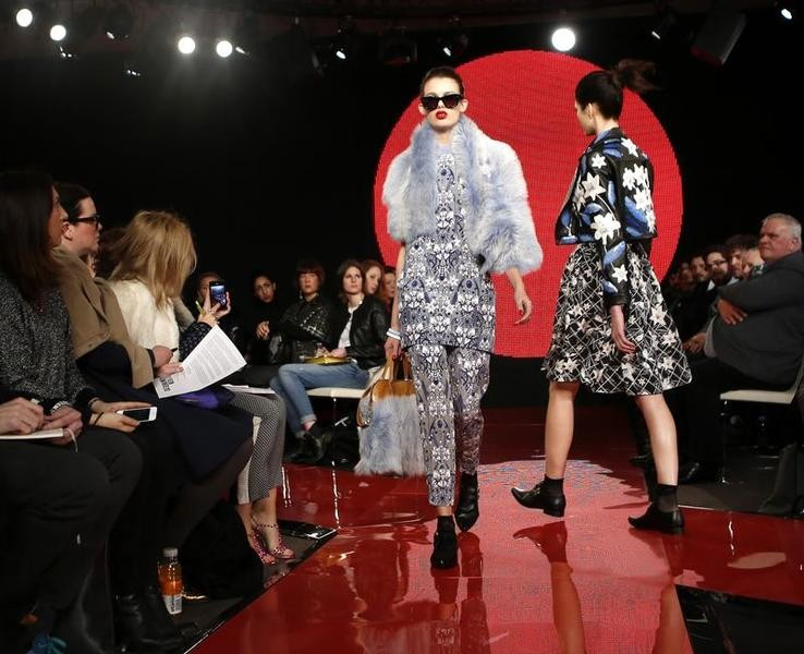 Models present creations from the Holly Fulton AutumnWinter 2013 collection during London Fashion Week, February 17, 2013.