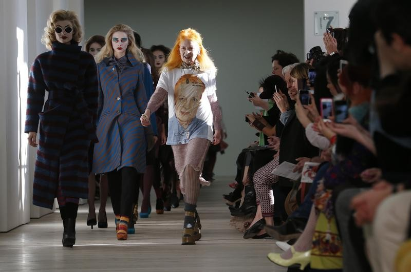 Vivienne Westwood joins her models on the catwalk after the Vivienne Westwood Red Label AutumnWinter 2013 collection presentation during London Fashion Week