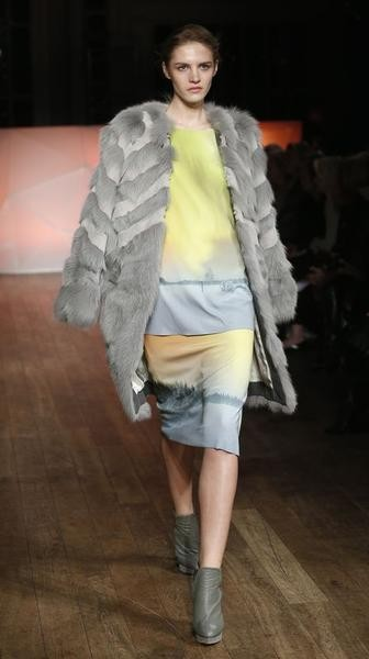 A model presents a creation from the Matthew Williamson AutumnWinter 2013 collection during London Fashion Week