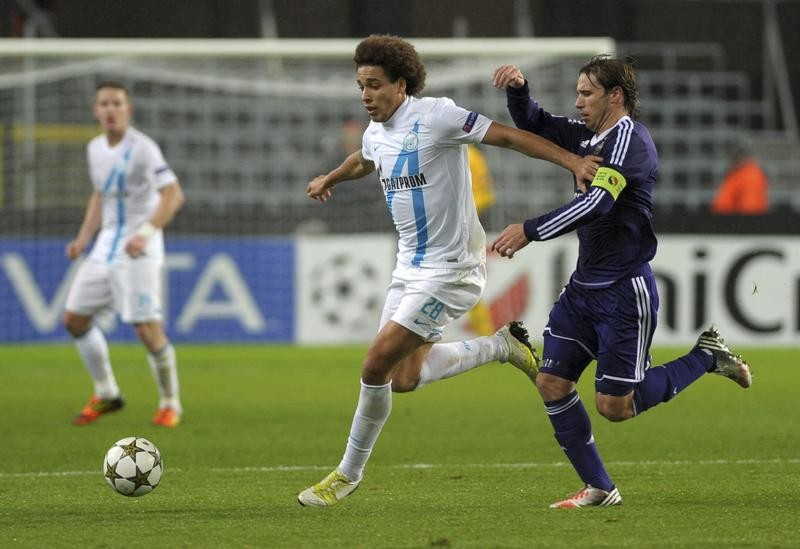 Axel Witsel and Lucas Bilglia fight for the ball