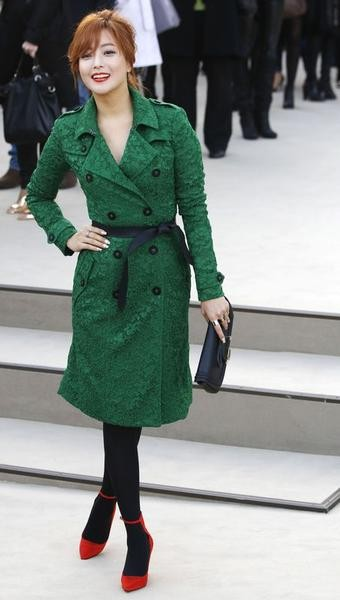South Korean actress Kim Hee-sun arrives for the Burberry Prorsum Womenswear AutumnWinter 2013 Show at Hyde Park in London February 18, 2013.
