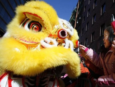 People take part in the 14th Annual Chinatown Lunar New Year Parade in New York, February 17, 2013. This year celebrates the year of the snake, according to the Chinese calendar.