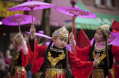 Girls perform a traditional dance during the Chinese New Year parade in Vancouver, British Columbia February 17, 2013. According to the Chinese zodiac, the Lunar New Year began on February 10 and marks the start of the Year of the Snake.