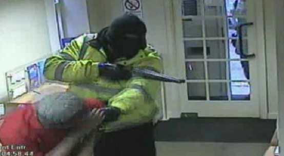 Hayes holds Benjamin Pullen hostage during heist