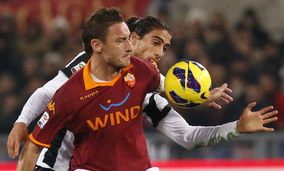 Francesco Totti and Martin Caceres