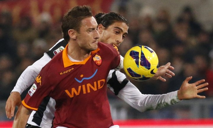 Francesco Totti and Martin Caceres