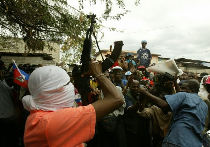 A masked leader of the Base Cameroon gang (Reuters