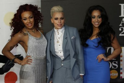 Pop group Stooshe arrive for the BRIT Awards, celebrating British pop music, at the O2 Arena in London February 20, 2013.