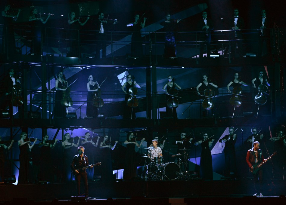 British rock band Muse performs during the BRIT Awards, celebrating British pop music, at the O2 Arena in London February 20, 2013.