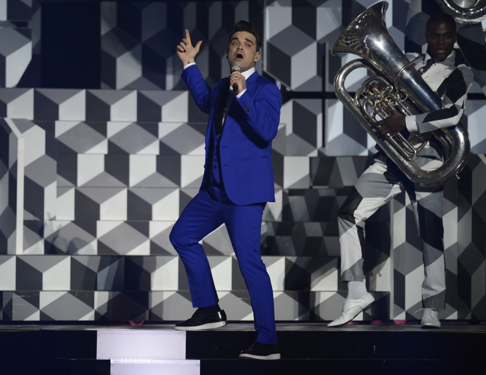 British singer Robbie Williams performs during the BRIT Awards, celebrating British pop music, at the O2 Arena in London February 20, 2013.