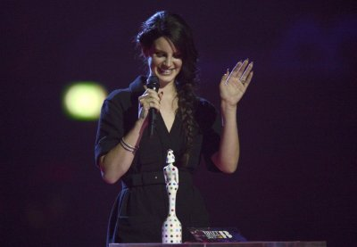 Singer Lana Del Rey reacts as she is presented with the International Female Artist award at the BRIT Awards, celebrating British pop music, at the O2 Arena in London February 20, 2013