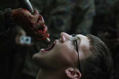 US Marines Drink Blood of Cobra