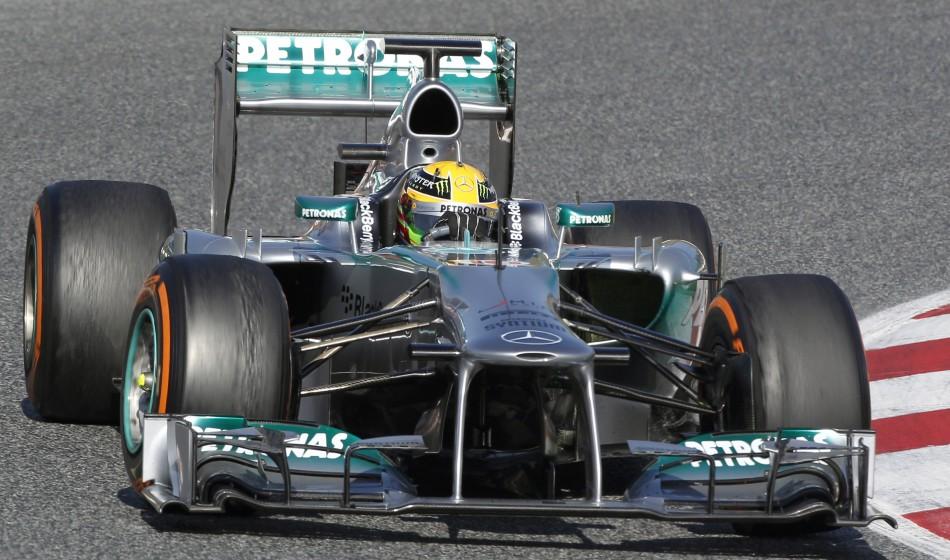 Hamilton takes a curve in Barcelona